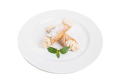 Waffle rolls with delicious whipped apricot cream. Stock Images