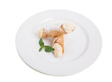 Waffle rolls with delicious whipped apricot cream. Stock Image