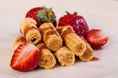 Waffle rolls with strawberries Royalty Free Stock Photography