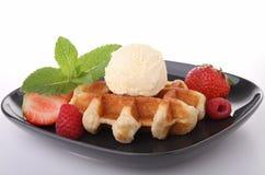 Waffle and scoop of vanilla ice cream Stock Photos