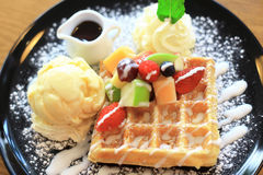 Waffle set with the ice cream, syrup, strawberry, apple. And some fruit stock photo