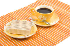 Waffle slice and coffee. Close-up waffle slice and cup with coffee on bamboo table-cloth Royalty Free Stock Photo