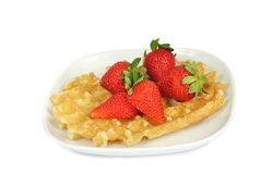 Waffle with strawberries on a plate Stock Image
