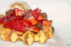 Waffle with strawberries. Waffles with strawberries, ice cream and chocolate Stock Photography