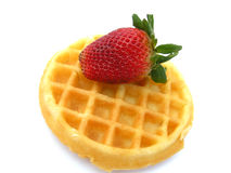 Waffle and strawberry. Round waffle with fresh strawberry on top isolated on white Royalty Free Stock Photos