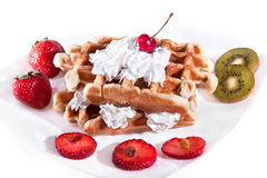Waffle with strawberry,cherry, kiwis. And vanilla cream, nice breakfast stock photography