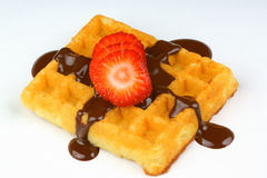 Waffle with strawberry slices and chocolate sauce Royalty Free Stock Photography