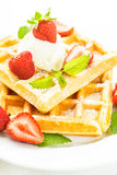 Waffle with strawberry Stock Images