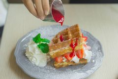 Waffle Strawberry with whipped cream for breakfast stock photos