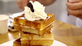 Waffle syrup and ice cream with whip cream topping, delicious sweet dessert stock video footage