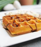 Waffle on top with chocolate. And banana Stock Photos