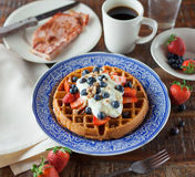 Waffle Topped With Black Round Fruit and Strawberries Royalty Free Stock Photos