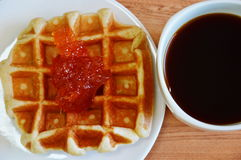 Waffle topping jam and black coffee Stock Photography