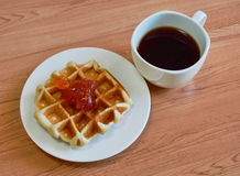 Waffle topping jam and black coffee Stock Photo