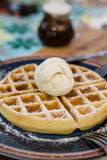 Waffle topping with vanilla ice cream. Waffle, topping with vanilla ice cream Stock Images