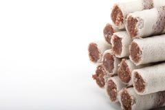 Waffle tubes with chocolate cream on white background Royalty Free Stock Images