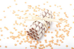 Waffle tubes with chocolate cream on white background with stars Royalty Free Stock Images