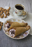 Waffle tubes with coffee and almonds Royalty Free Stock Photography