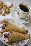 Waffle tubes with coffee and almonds Royalty Free Stock Photos