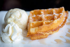 Waffle and vanilla ice cream two scoops and maple syrup. Popular sweets and dessert. sweet, fat and high calories. image for background, wallpaper, copy space stock photography