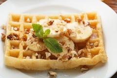 Waffle with walnuts and bananas Royalty Free Stock Photo