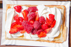 Waffle with whipped cream and berries Stock Photo