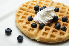 Waffle with Whipped Cream and Blueberries Royalty Free Stock Photography