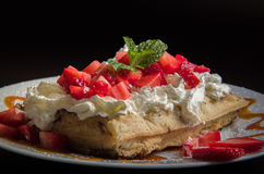 Waffle with whipped cream and strawberry Royalty Free Stock Photography