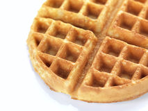Waffle in a white backround. A close up of a waffle royalty free stock photos