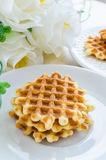 Waffle. In white dish on the wood table Royalty Free Stock Image
