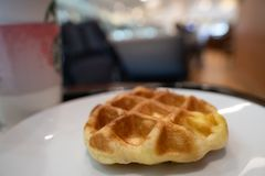 The waffle on white plate. Selective focus