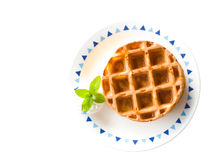 Wafflem, mint and cream on plate Royalty Free Stock Photography