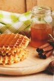 Waffles и стекло с медом Стоковые Фото