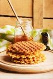 Waffles и стекло с медом Стоковая Фотография