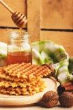 Waffles и стекло с медом Стоковое Изображение