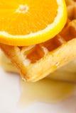 Waffles, мед и апельсин на плите изолированной на белизне Стоковое фото RF