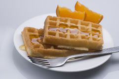 Waffles. And honey for breakfast Stock Photography