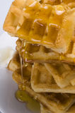 Waffles. A breakfast of Waffles dripping with honey Royalty Free Stock Photography