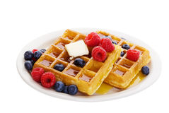 Waffles. With mixed fruit and maple syrup