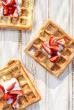 Waffles with addition fresh strawberries Stock Photography