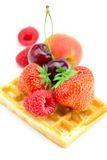 Waffles,apricot,cherries, strawberries raspberries Royalty Free Stock Images