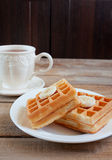 Waffles with banana and cup of tea Royalty Free Stock Photo
