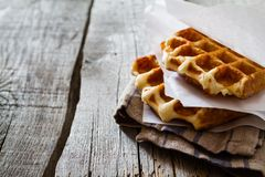 Waffles with banana and nuts honey. Rustic wood background Royalty Free Stock Photo