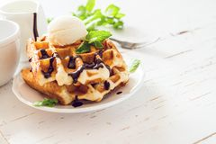 Waffles with banana and nuts honey. White wood background, toned Royalty Free Stock Images