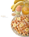 Waffles with banana Royalty Free Stock Images