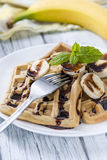 Waffles with Bananas and Chocolate Sauce Royalty Free Stock Photo