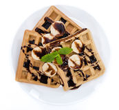 Waffles with Bananas and Chocolate Sauce (over white) Stock Photos