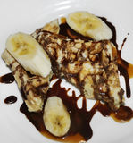 Waffles With Bananas And Chocolate Syrup Royalty Free Stock Photo