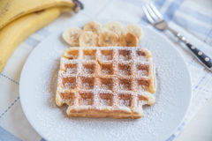 Waffles with bananas Stock Images