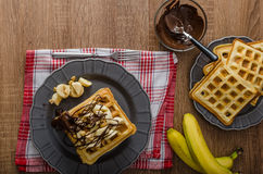 Waffles with bananas, nuts and chocolate Royalty Free Stock Image